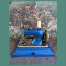 **Bright blue colored  Casige sewing machine**