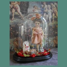 **Wonderful cabinet size doll under a dome with her accessories.***