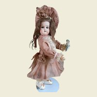 """Cute 12""""cabinet size doll with lovely costume."""