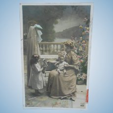 French tinted real photo postcard++Girl with her doll romantic ++