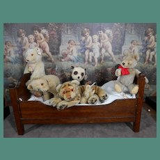 ****An oak doll bed filled with Steiff animals****