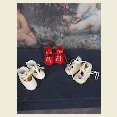 Three pair of tiny shoes 1,4 inches sole size !