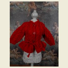 A red hand knitted cardigan for your doll.
