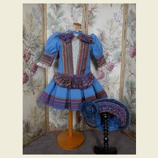 Amazing costume blue with striped details and matching hat.