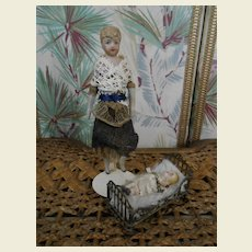 **Dollhouse lady with baby in crib....***approx 1900