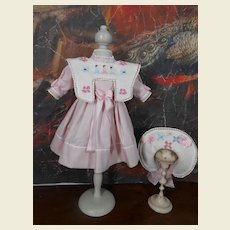 Lovely hand embroidered pink dress/costume with a matching hat....
