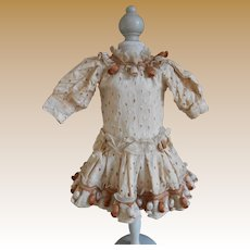 **Sweet Broderie Anglaise dress with many tassels***