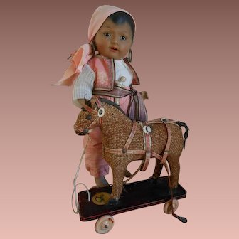 Nice price !!! Lovely Horse pull toy .....small size ! Perfect for a doll display.