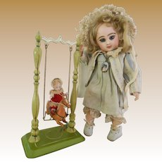 ****Very rare small accessory for your Mignonette doll..A tin swinging, rocking horse***