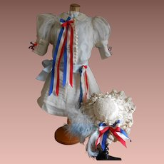 "A gorgeous ""Tête Jumeau"" costume with France flag bows and ribbons."