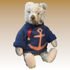 ** A cute, 16,8 inches Steiff Teddy bear....a friend for your doll......