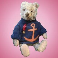 ** A cute, 16,8 inches Steiff Teddy bear....a friend for your doll......