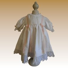 **A sweet white cotton dress with pink ribbons and bows****