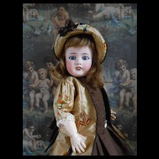**French Bébé Limoges**with a beautiful costume....