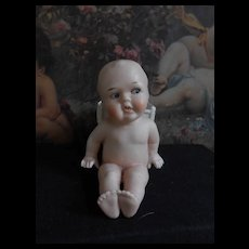 **Cute antique all bisque baby with basket****