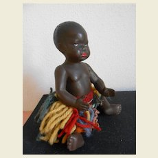 Sweet little mulatto baby, made by the French factory Petitcollin .approx 1925
