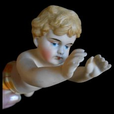 **A rare 6,4 inches swimming all bisque figure...as a boy****