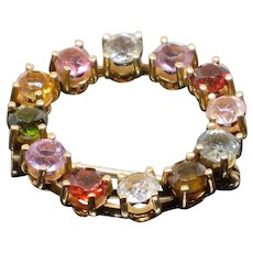Vintage rainbow colored gemstone and gold brooch, 18k, 2.5 ct. tw.