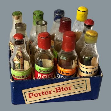 Great beer crate full with glass bottles for doll store