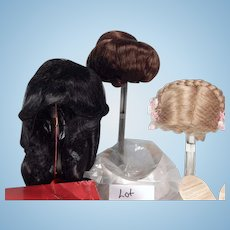 Box lot of three doll wigs for doll making/repair.