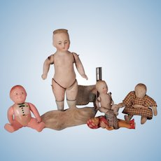 cute lot of Bisque And Plastic dolls