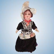 Cute little German bisque doll dressed as a Dutch woman