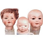 Three Flawed German Bisque baby heads