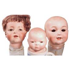 Three Flawed German Bisque baby heads