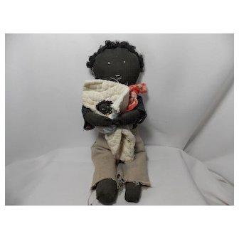 Vintage Black Rag Doll holding Black Baby Doll