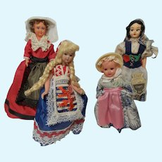 Collection of Four Travel Souvenir Dolls from Europe