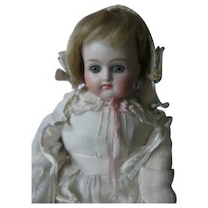 Kestner turn head closed mouth doll. 16 inches or 40 cm.