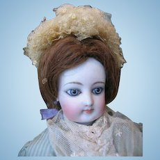 Gaultier fashion doll swivel neck doll  16  inches or 40 cm , old clothing.