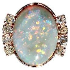 Art Deco Custom Australian Black Opal and Old Mine Cut Diamond Cocktail Ring in 14 Karat Rose Gold; A Robust Design (COLR10144)