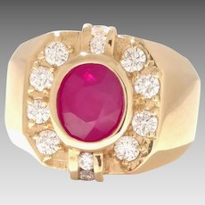 Estate Man's 18KT Yellow Large Oval Faceted Natural Ruby, Surrounded by Fine Diamonds Circa 1976 (GOLD10053)