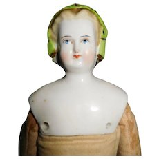 "11 1/2"" Antique Blond China Head Doll With Molded Snood & Colored Band Decoration In Hair"