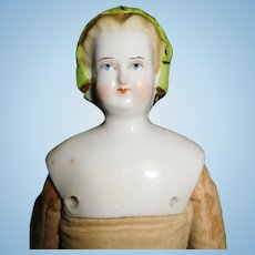 """11 1/2"""" Antique Blond China Head Doll With Molded Snood & Colored Band Decoration In Hair"""