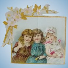Antique Victorian Card of Girls with a Doll