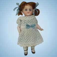 "Antique All Bisque 4 1/2"" Doll With Glass Eyes"