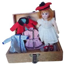 """Antique 7"""" Bisque Head Doll With Wardrobe and Trunk"""