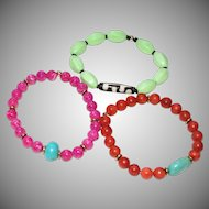 Trio of Colorful Stretch Bracelets of Orange Sponge Coral,  Lime Green Magnesite and Pink Fossil Stone