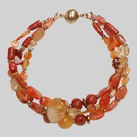 Shades of Orange Carnelian, Coral, and Citrine 3 strand bracelet
