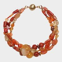 Shades of Orange Carnelian, Coral, and Citrine 3 strand bracelet