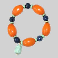 African Copal Beads, Varacite and Dutiermorite with Carved Turquoise Frog Bracelet