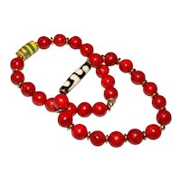 Pair of Red Fossil Stone (dyed) Bracelets with Vintage African Bead and Batik Bone Bead