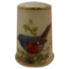 Late 19thc Worcester biscuit porcelain thimble decorated with a bird. c 1880
