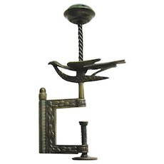 A brass hemming bird sewing clamp with needle holder. c 1850