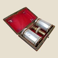Pair of antique pearl opera glasses in leather case. Early 19th century.