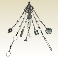 An exceptional cut steel chatelaine. c 1850