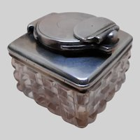 Silver mounted cut glass travelling inkwell with locking mechanism. c 1832