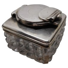 Silver mounted cut glass inkwell with locking mechanism. c 1830